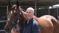 Trainer John Moloney: bone had pieced skin, but 'I just rode on'
